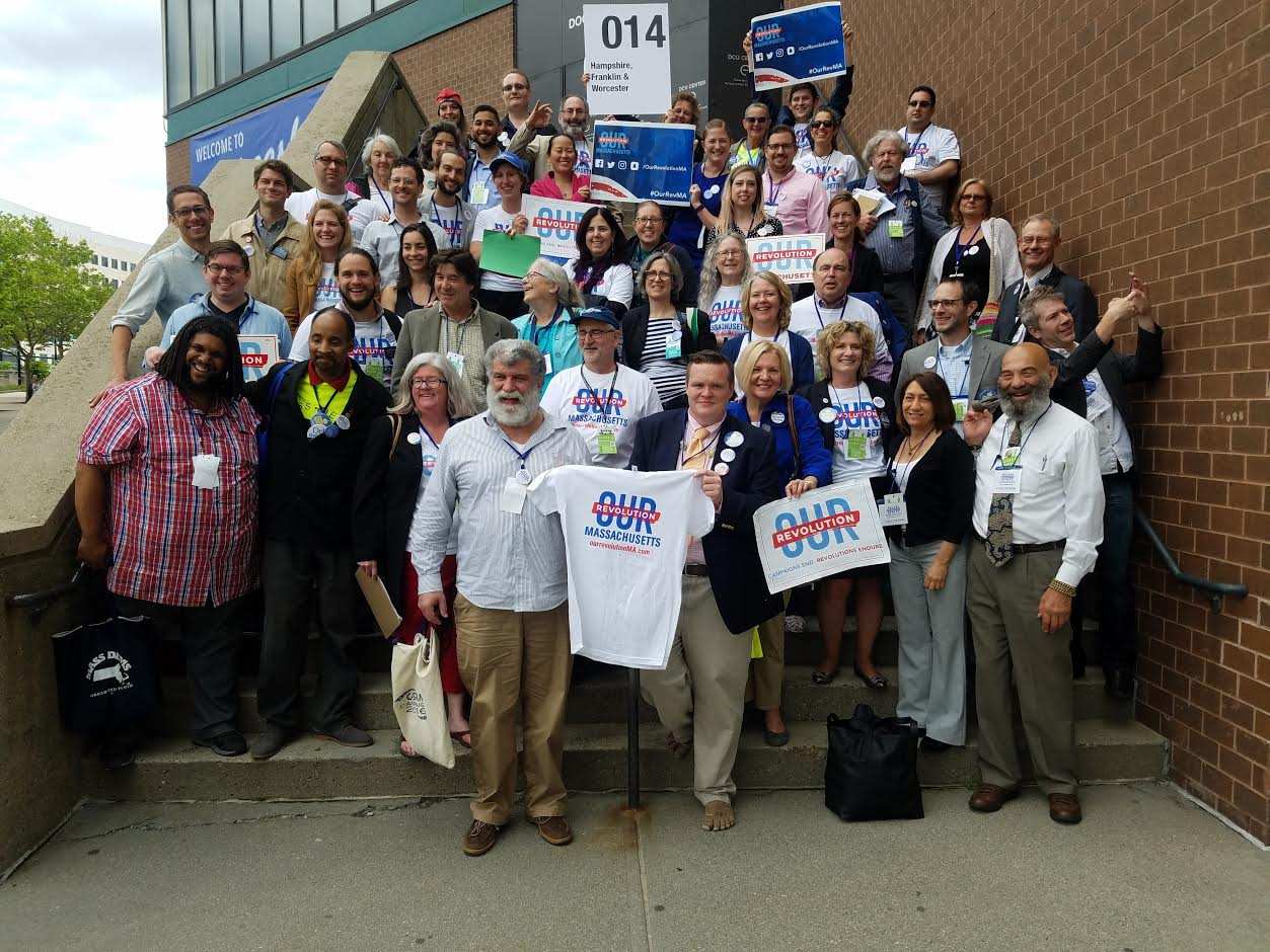 Our Revolution Massachusetts delegates celebrate victory outside Worcester's DCU Center